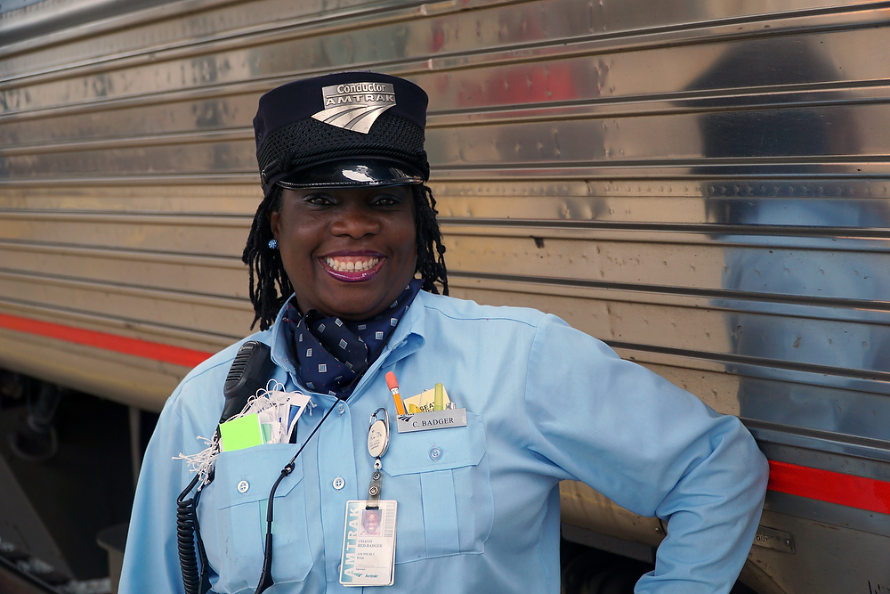 Celeste is the conductor on the Amtrak Crescent She obviously loves what she's doing. ©2015 Bob Carey (Sony a6000, Zeiss Touit 32mm – 1/320, f4, iso 250)
